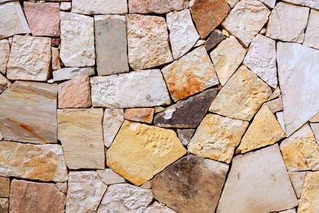 Pattern of decorative colorful stone wall background. Stone wall texture abstract wall. Фото со стока