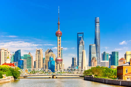 Shanghai pudong skyline with historical Waibaidu bridge, China during summer sunny day. Фото со стока