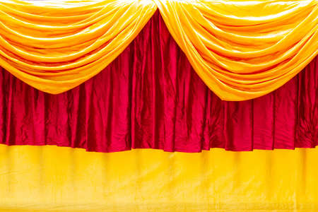 Red and yellow stage theater curtain as a background