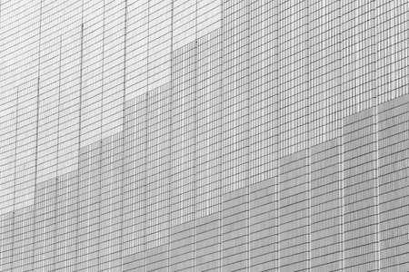 Abstract architecture pattern. Grey and white odern building wall abstract texture city background Фото со стока
