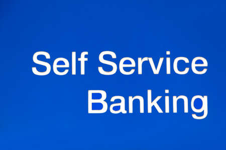 Self service banking sign on blue background. Finance business concept