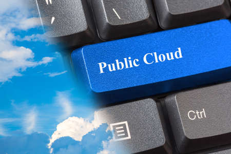 Blue colored Public Cloud button on black computer keyboard with nice blue cloudy sky. Public cloud services offered by providers concept