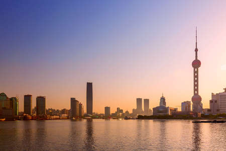 Cityscape of Shanghai at sunrise. Panoramic view of Pudong business district skyline from the Bund