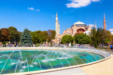 Istanbul, Turkey - August, 2018: Hagia Sophia Ayasofya museum with fountain in the Sultanahmet Park in Istanbul, Turkey during sunny summer day
