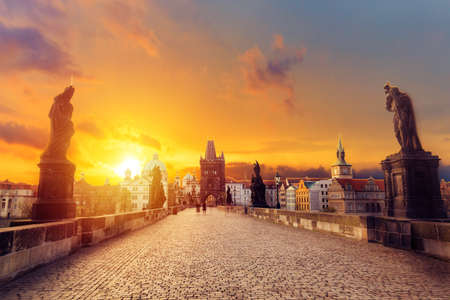 Charles Bridge Karluv Most and Old Town Tower at amazing sunrise with sky and clouds in Prague, Czech Republic 版權商用圖片