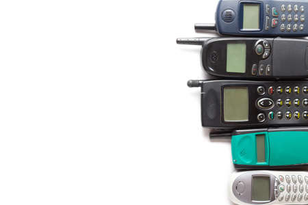 Old retro mobile phones isolated on white background. Copy space.