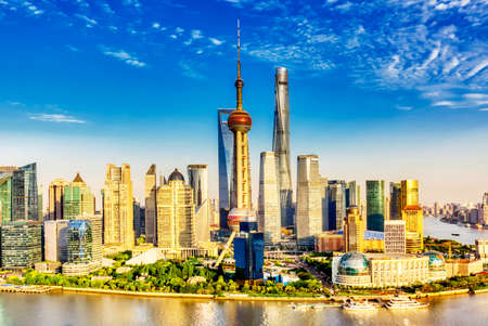 Shanghai city skyline with huangpu river. Pudong business district in Shanghai, China with blue sky during summer sunny day Stock Photo