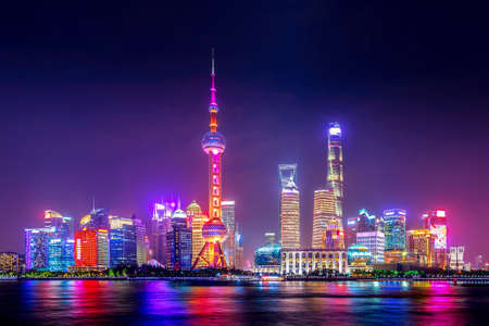 Cityscape of Shanghai at twilight sunset. Panoramic view of Pudong business district skyline from the Bund Stock Photo
