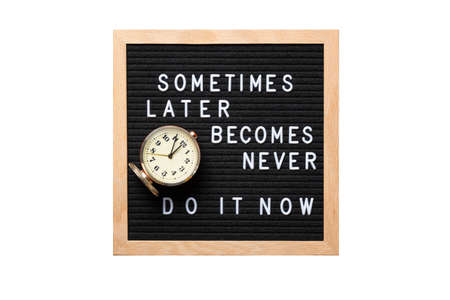Inspirational motivational quote Sometimes later becomes never. Do it now words on a letter board with vintage alarm clock isolated on white background. Success and motivation concept. Business mockup.