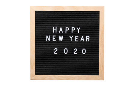 Christmas or new year frame or mockup for your project. Happy new year 2020 words on a letter board isolated on white background.
