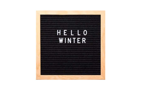Christmas or new year frame or mockup for your project. Seasonal frame. Hello Winter words on a letter board isolated on white background