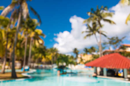 Blurred defocused vacation background with swimming pool bar in luxury tropical hotel resort. Stock Photo