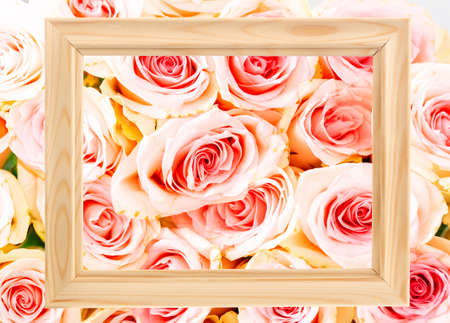Bright pink natural roses with a wooden frame as a background. Flowers mockup.