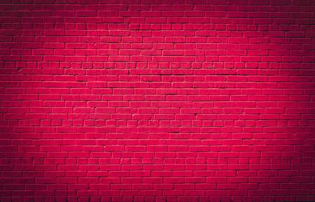 Pink brick wall texture background. Magenta colored brick wall texture architexture pattern