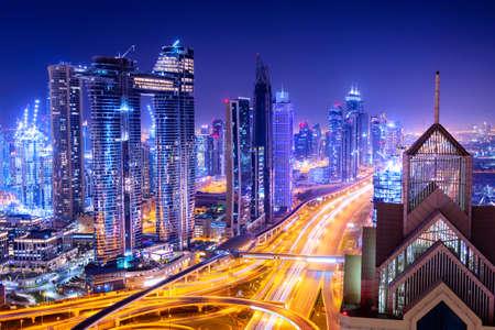 Amazing skyline cityscape with illuminated skyscrapers. Downtown of Dubai at night, United Arab Emirates