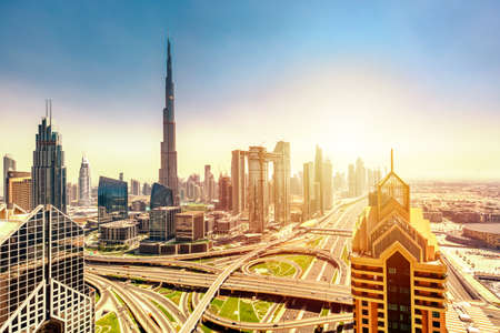 Amazing skyline cityscape with modern skyscrapers. Downtown of Dubai at sunny day during sunrise, United Arab Emirates