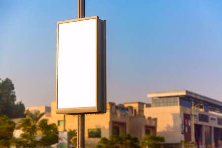Advertisement mockup. Blank empty billboard on the city street in Dubai, UAE Stock Photo