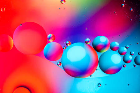 Abstract background with colorful gradient colors. Oil drops in water abstract psychedelic pattern image. Colorful abstract pattern.