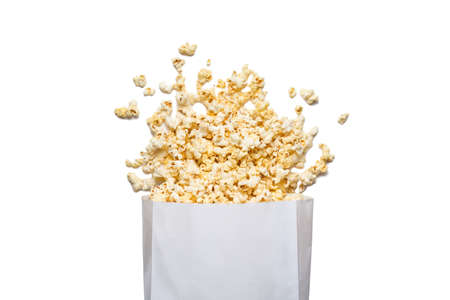 Fresh tasty salty popcorn with a box isolated on white background.