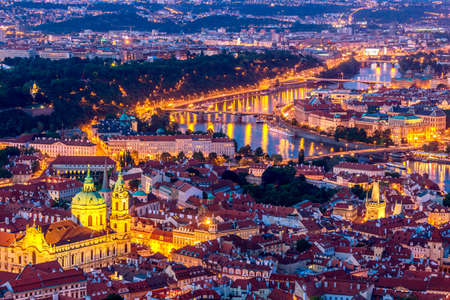 Illuminated Prague at twilight blue hour. VIew from Petrin hill.