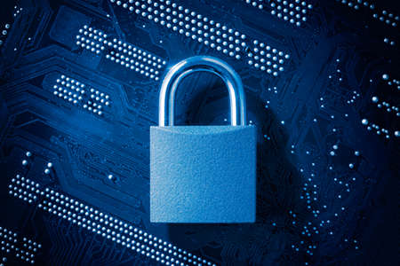 Padlock on computer motherboard. Internet data privacy information security concept. Antivirus and malware multilayer defense 스톡 콘텐츠