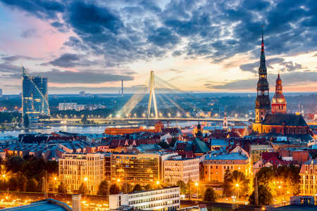 Beautiful aerial panorama of Riga center and Vansu bridge over Daugava river during amazing sunset. View of illuminated Riga city, capital of Latvia