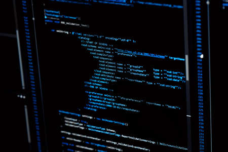 Information technology concept. Coding programmer language script text on screen monitor display. Programmer occupation job. Selective focus.