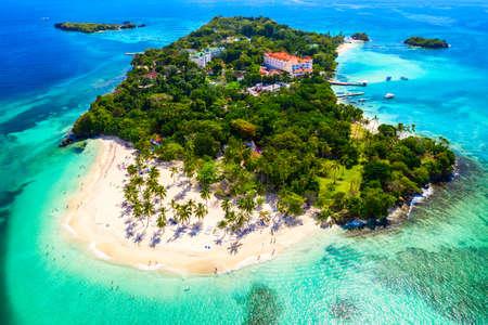 Aerial drone view of beautiful caribbean tropical island Cayo Levantado beach with palms.