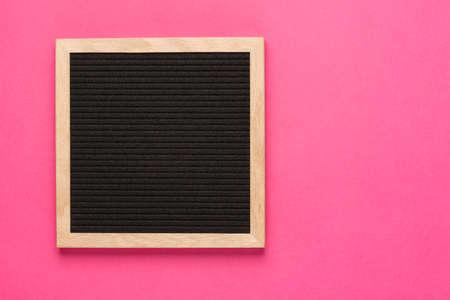 Empty black letterboard on pink background. Design mockup.