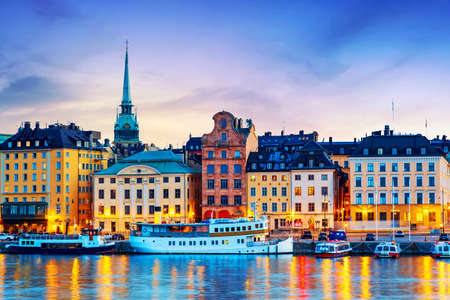 Scenic summer sunset panorama of the Old Town Gamla Stan architecture in Stockholm, Sweden.