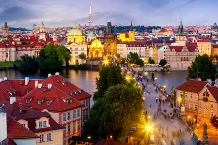 Aerial view of Charles Bridge, old town and Zizkov TV Tower in Prague, Czech Republic during sunset time. World famous landmarks in Europe