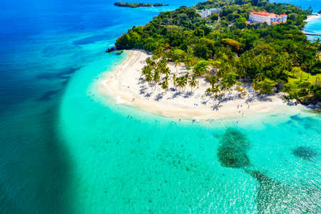 Aerial drone view of beautiful caribbean tropical island Cayo Levantado beach with palms. Bacardi Island, Dominican Republic. Vacation background.