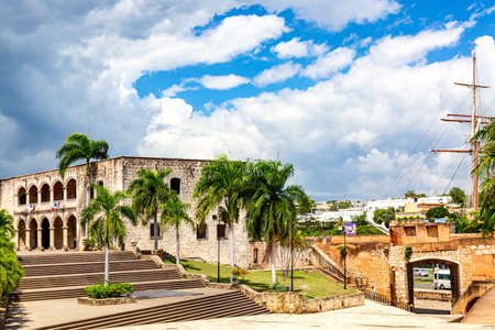View of Alcazar de Colon Diego Columbus Residence from Spanish Square with blue sky. Famous colonial landmark in Dominican Republic.