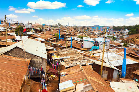 Kibera slum in Nairobi during sunny day with blue sky and clouds. Kibera is the biggest slum in Africa. Slums in Nairobi, Kenya