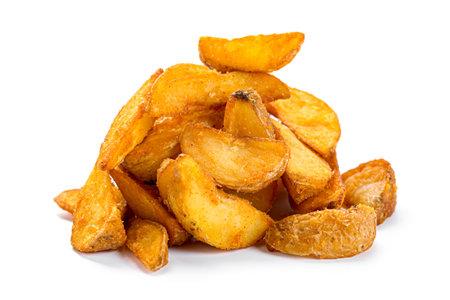 Fried potato wedges isolated on white background. Baked tasty potato slices. Imagens