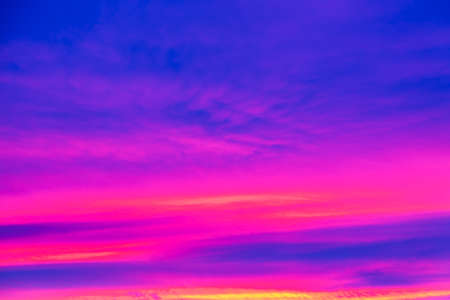 Vivid saturated beautiful sunset sky in pink, purple and blue colors. Sunset background. Archivio Fotografico