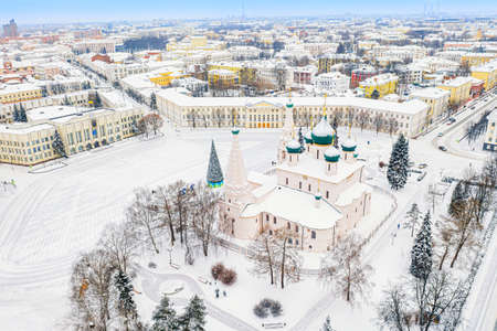 Aerial drone view of Orthodox Church of Elijah the Prophet and old city center in winter of Yaroslavl, Russia. Ancient Russian city of the touristic Golden Ring