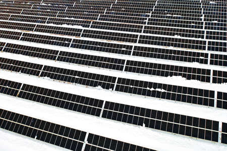 Renewable energy concept. Aerial drone view of solar panels power plant in winter. Archivio Fotografico