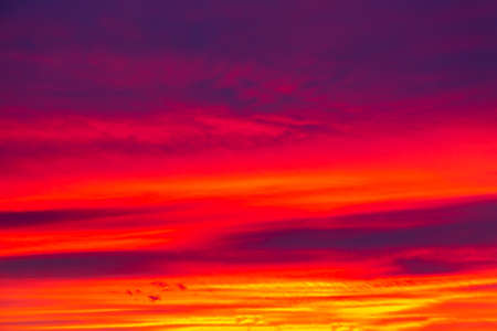 Vivid saturated beautiful sunset sky in red, purple and blue colors. Sunset background. Archivio Fotografico
