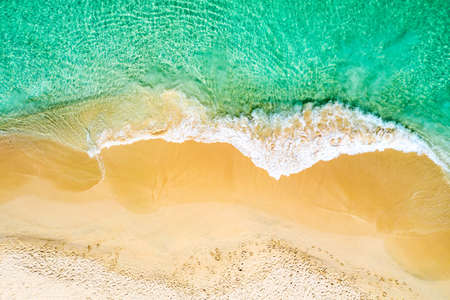 Top view aerial drone photo of ocean seashore with beautiful turquoise water and sea waves. Caribbean resort. Vacation travel background Фото со стока