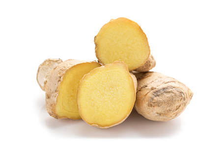 Close up of fresh ginger roots isolated on white background.