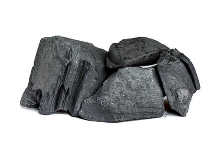 Wood charcoal pieces isolated on white background.