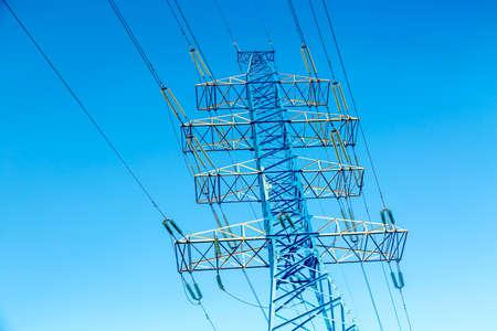 High voltage power pylon against nice blue sky. Energy concept. Фото со стока