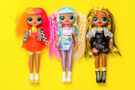 Moscow, Russia - March, 2021: LOL OMG dolls on yellow background. Collection of dolls lol. Popular dolls for girls. Редакционное