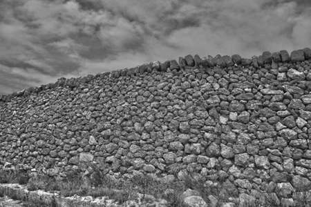 ancient dry wall in the Apulian territory 写真素材