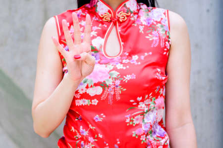 a woman in a Chinese dress