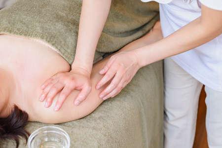 A woman doing a massage taken at an esthetic salon Stok Fotoğraf