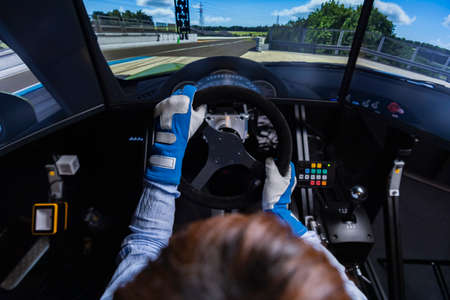 Driving a car in a driving simulator Foto de archivo