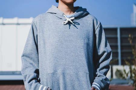 a woman in a hoodie Foto de archivo