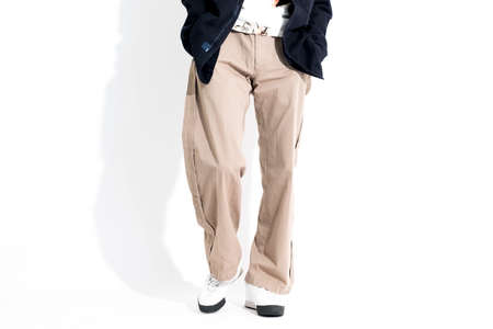The legs of the male model who makes a pose Foto de archivo